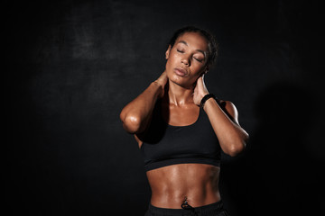 Confident fit young african fitness woman