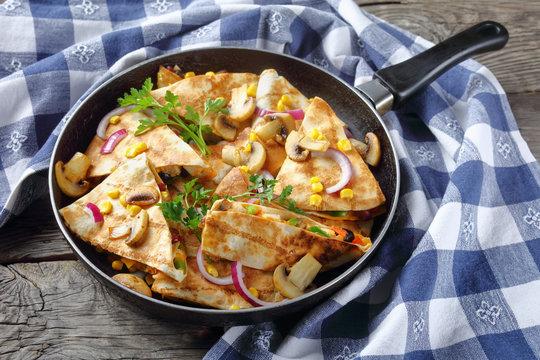 sliced quesadilla with chicken, tomato, sweet corn