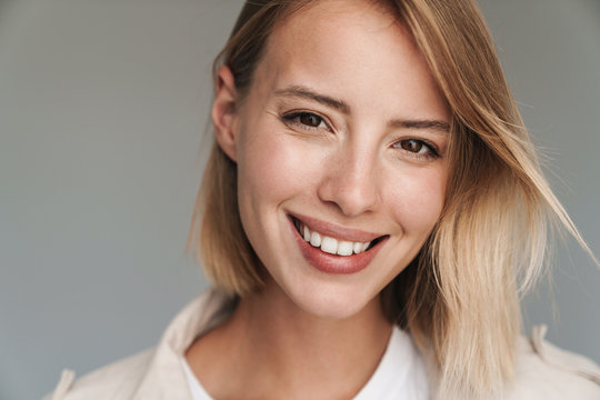 Close up of a lovely young blonde short haired woman