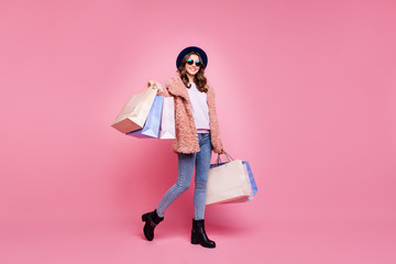 Full length photo of pretty youngster lady carry many packs shopper enjoy abroad sales mall wear...