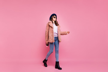 Fototapete - Full length profile photo of amazing millennial lady going down foreign street wearing stylish youth fluffy autumn jacket jeans shoes specs hat boots isolated pink background