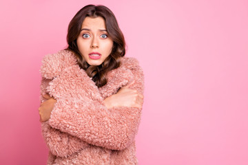 Photo of amazing millennial model lady hugging herself unexpected chilly weather wearing stylish youth fluffy autumn jacket isolated pink background