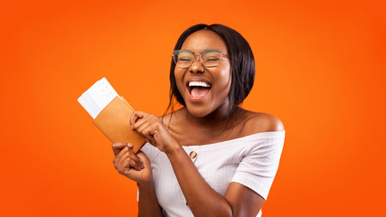 Excited Lady Holding Tickets And Passport Shouting On Orange Background