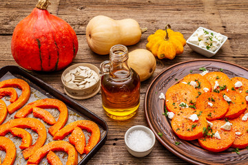 Roasted and baked pumpkin with salted cheese and herbs