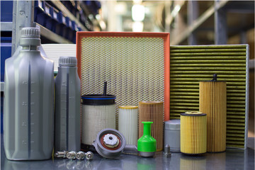 Oil filter, air filter, cabin filter, fuel filter, spark plugs, engine oil. Auto parts close up.