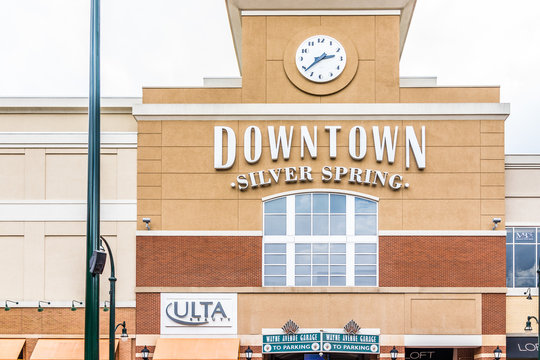 Silver Spring, USA - September 16, 2017: Downtown area of city in Maryland with large sign on mall building and clock