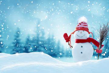 Happy  snowman standing in christmas landscape.Snow background.Winter fairytale.Merry christmas and...