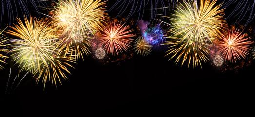 Fireworks explosions on black
