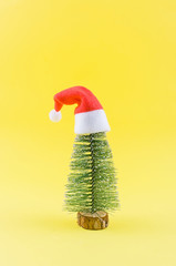Christmas or New Year yellow background with Christmas tree