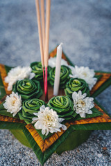 Krathong, the hand crafted floating candle made of floating part decorated with green leaves colorful flowers