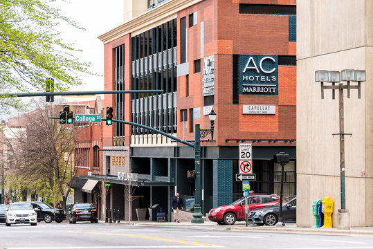 Asheville, USA - April 19, 2018: Downtown old town College street in North Carolina NC famous town, city with stores, shops, sign for AC Marriott hotel
