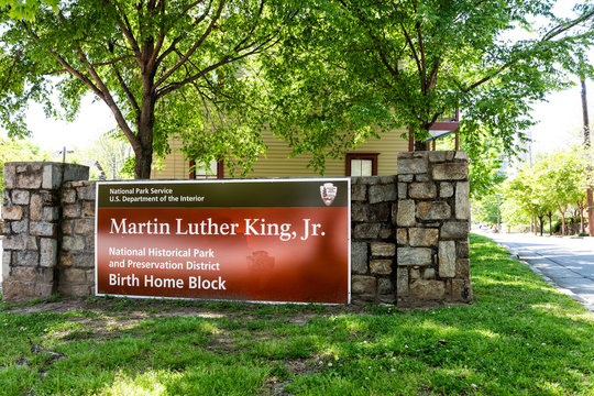 Atlanta, USA - April 20, 2018: Historic MLK Martin Luther King Jr National Park sign of birth home block in Georgia downtown, green trees in urban city
