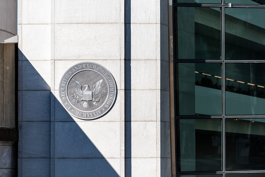 Washington DC, USA - October 12, 2018: US United States Securities and Exchange Commission SEC entrance architecture modern building closeup sign, logo, glass windows