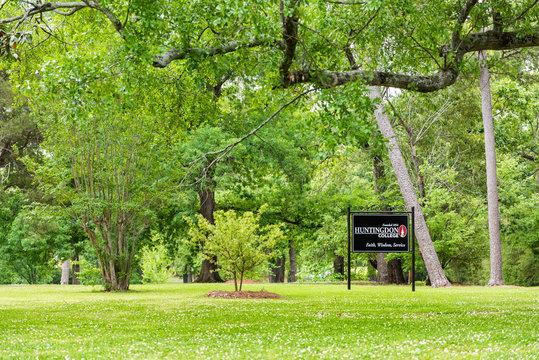 Montgomery, USA - April 21, 2018: Sign for private liberal arts Huntingdon College in Alabama with green park entrance