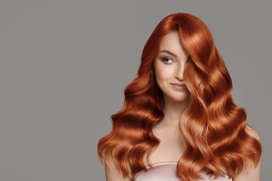 Portrait of beautiful redhair woman. Wavy hairstyle.