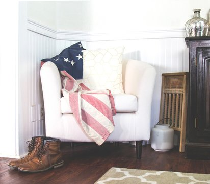American Flag Over Chair with Boots