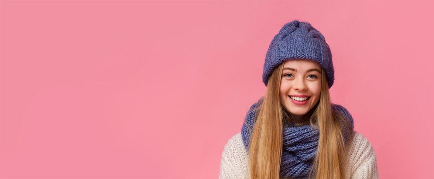 Portrait of smiling girl in winter hat with free space