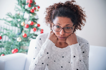 Worried black young woman at home on christmas holiday