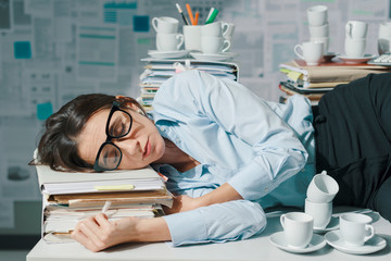 Businesswoman sleeping in the office