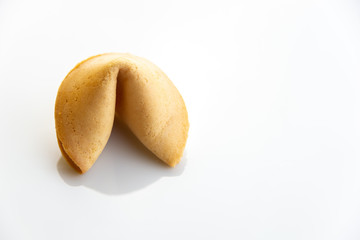 Chinese fortune cookies with golden and brown color and white background