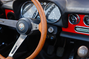 Vintage Alfa Romeo car interior - steering wheel dashboard and gear shift