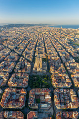 Spain, Catalunya, Barcelona, Aerial view of Eixample district and Sagrada Familia Cathedral