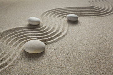 Photo sur Plexiglas Zen pierres a sable zen garden stones in light sand for relaxation and concentration during meditation