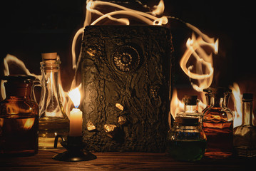 Magic book and magic potions on a wizard table. Witchcraft. Wall mural