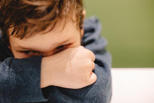 Boy leaning on desk