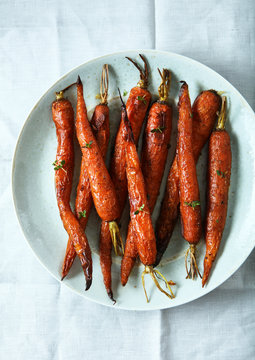 Overhead view of baked carrots served on plate