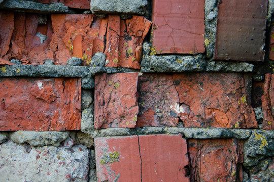 Old brick wall, cracked cinder block