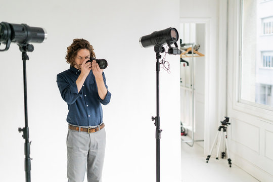 Photographer taking pictures in his studio