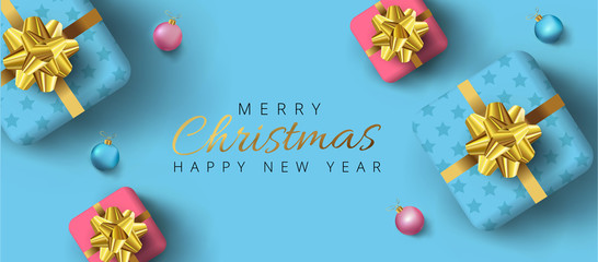 Merry Christmas and happy new year lettering, Realistic gift boxes, baubles around on dark blue background. Can be used as poster,banner or template design.