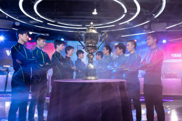 Young Chinese men taking part in esports competition