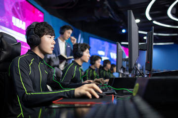 Young Chinese men playing esports