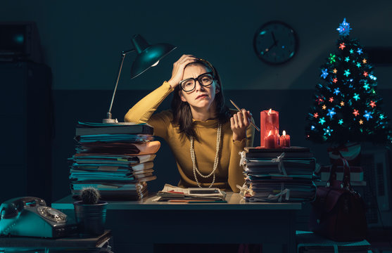 Frustrated businesswoman working on Christmas Eve