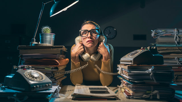 Frustrated secretary working overtime at night