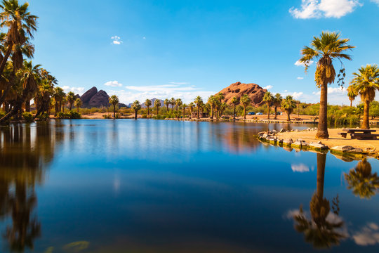 Serene, tranquil scenery of Papago park, one of the famous places in Phoenix Arizona. Bright, colorful and a beautiful day with blue sky and clear water surface.