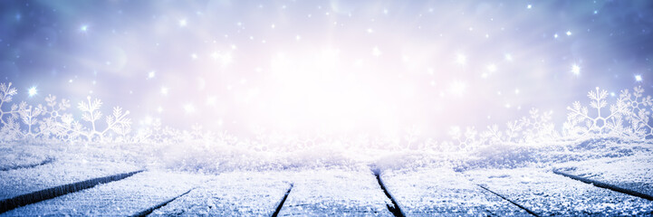 Banner Of Wooden Plank Table With Sparkling Snow And Brilliant Explosion Background - Winter