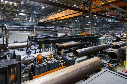 Pipe factory production line, unfinished pipe moving on roller conveyor