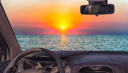 Car windshield view of scenic sunset on the mediterranean sea