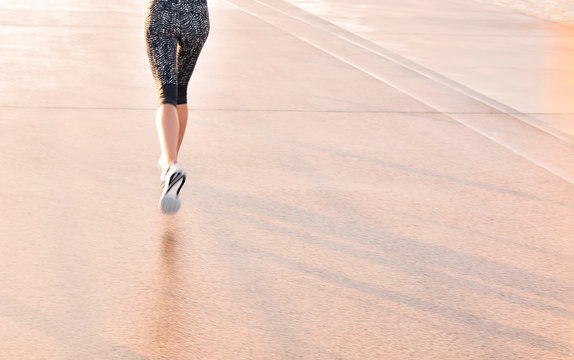 Woman enjoys running outside on the quais of Bordeaux, France. Copy space.