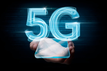 5G hologram created in light strokes technique over futuristic transparent smartphone. New high speed internet connection for fastest worldwide connections ever. Smart 5G network concept - Image