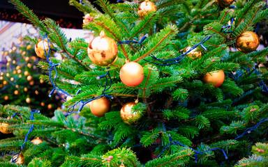 Glass Christmas tree decorations of Christmas market of Germany in Europe in winter. German Night street Xmas and holiday fair in European city or town, December. Berlin in Gendarmenmarkt bazaar