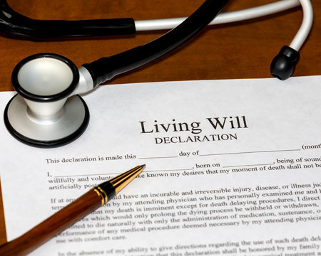 Living Will declaration form with stethoscope and ballpoint pen. Concept of planning end of life medical and healthcare wishes