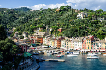 Sea bay with beautiful picturesque village called Portofino. Small marina port at the foot of mountain with a beautiful colourful houses village