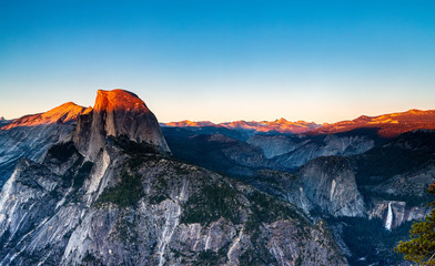 Panoramic View of Sunlight Lighting the Mountain Tops of Half Dome and Yosemite Valley at Sunset in Yosemite National Park