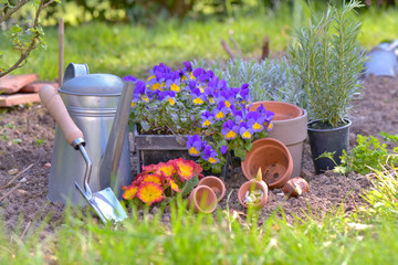 gardening equipment and flowerpots put on the soil in a garden