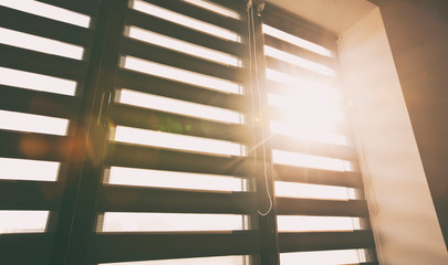 Sunlight enters the room through the blinds
