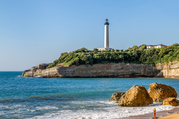 Biarritz Lighthouse (Faro de Biarritz) on the cliff. Holidays on the Basque coast of France.